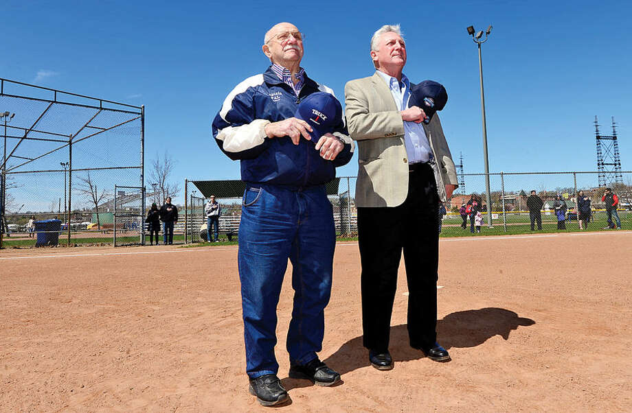 Hour photo / Erik Trautmann Al Palumbo and mayor Harry Rilling were on hand to throw out the first pitches during the Norwalk Little League opening day ceremonies Saturday at Veteran's Park.