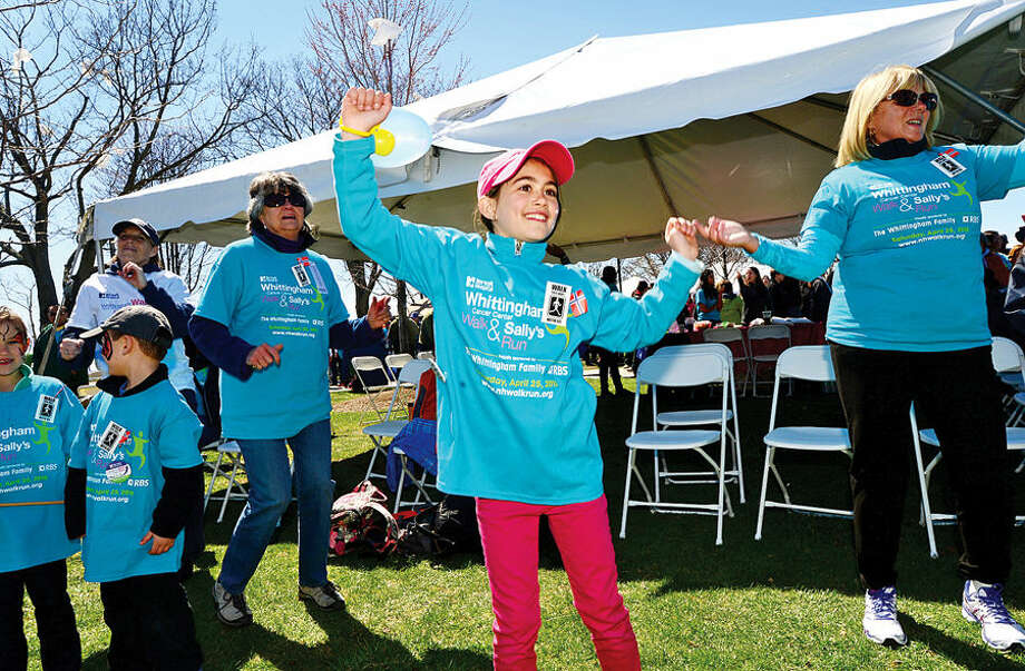 Hour photo / Erik Trautmann 9 year old Adrinna Ording warms up for the Whittingham Cancer Walk and Sally's Run at Calf Pasture Beach Saturday.