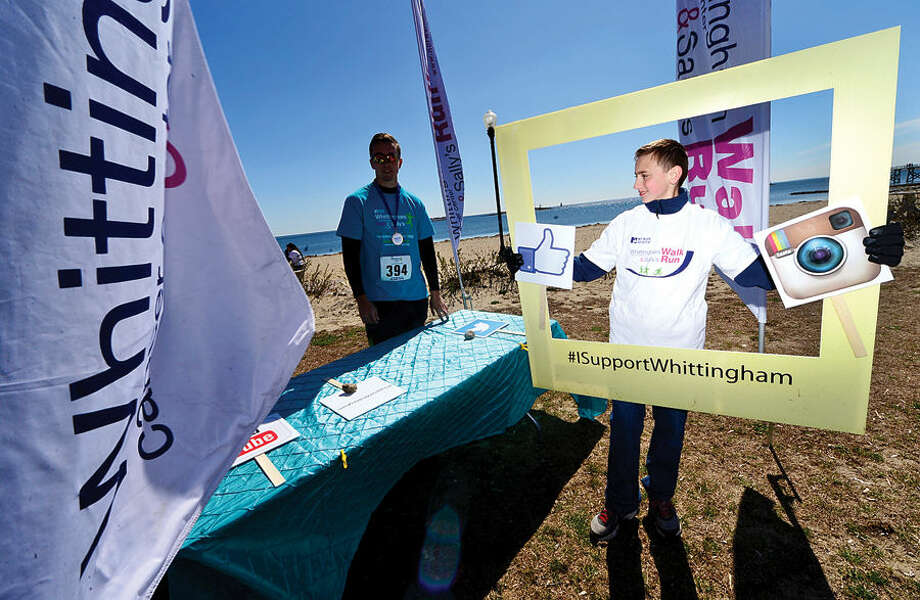 Hour photo / Erik Trautmann Marcel Koszkul promotes the Whittingham Cancer Walk and Sally's Run on social media at Calf Pasture Beach Saturday.