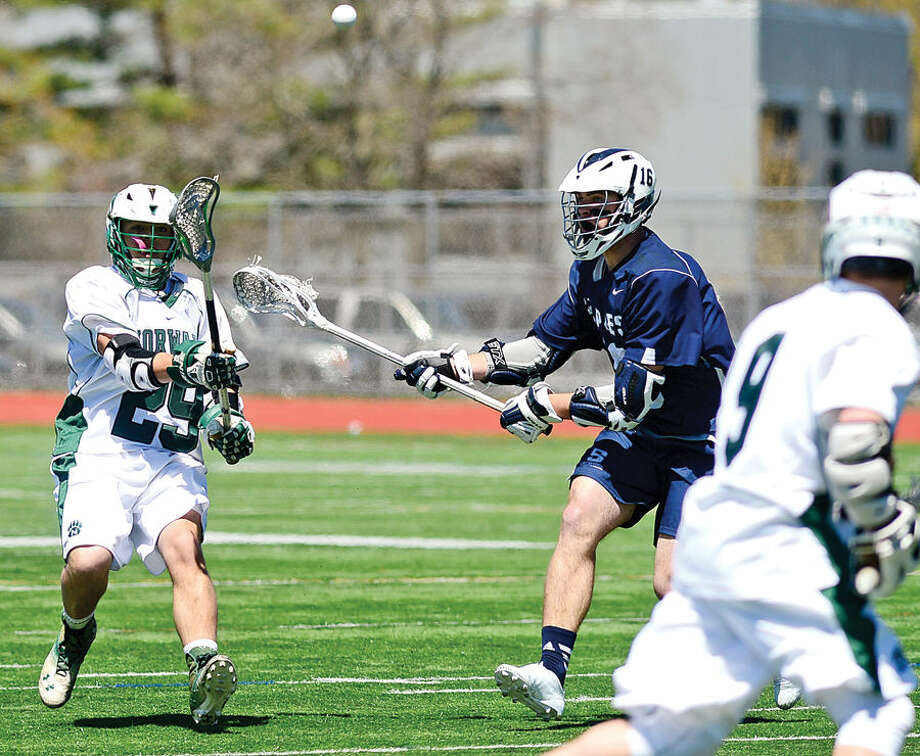 Hour photo / Erik Trautmann The Norwalk High School Bears take on Staples High School during their boys lacrosse match up at testa Field in Norwalk Saturday.
