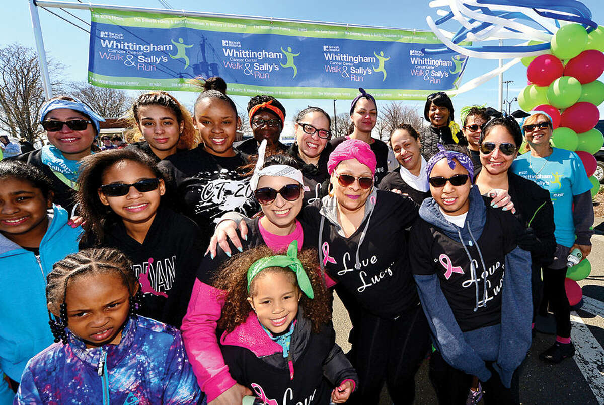 Hour photo / Erik Trautmann Cancer survivor Lucy Navarro, center right, prepares for Whittingham Cancer Walk and Sally's Run withher family and friends at Calf Pasture Beach Saturday.