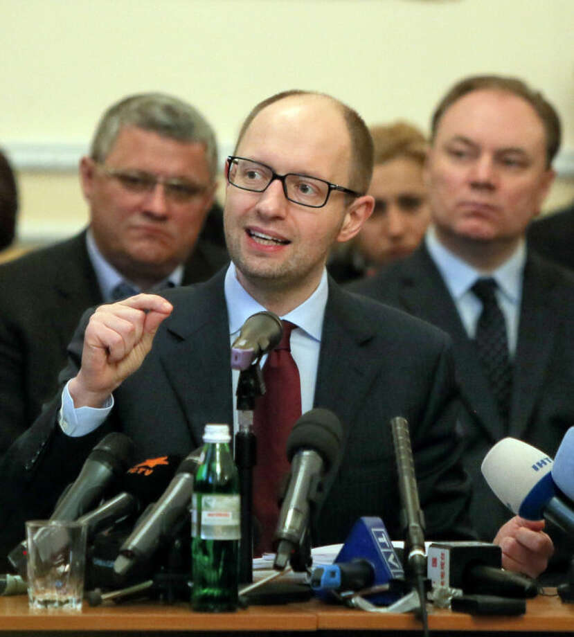 Ukraine's prime minister Arseniy Yatsenyuk speaks during his meeting with regional leaders in Donetsk, Ukraine, Friday, April 11, 2014. Ukraine's prime minister on Friday told leaders in the country's restive east that he is committed to allowing regions to have more powers. Yatsenyuk Friday morning flew into Donetsk, where pro-Russian separatists are occupying the regional administration building and calling for a referendum that could prefigure seeking annexation by Russia. (AP Photo/Efrem Lukatsky)