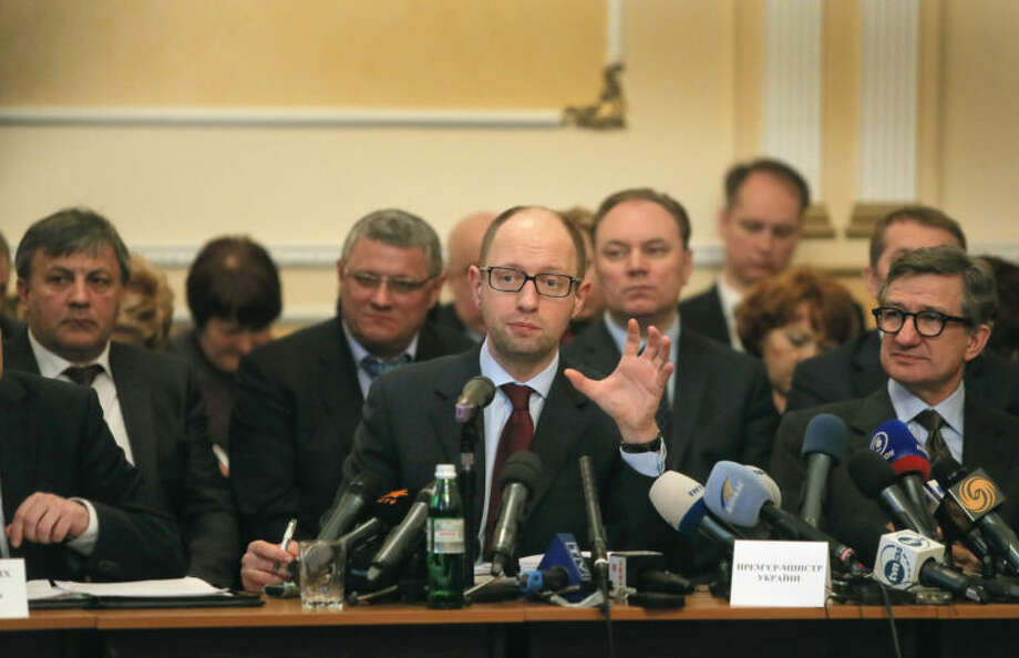 Ukraine's prime minister Arseniy Yatsenyuk, center, speaks during his meeting with regional leaders in Donetsk, Ukraine, Friday, April 11, 2014. Ukraine's prime minister on Friday told leaders in the country's restive east that he is committed to allowing regions to have more powers. Yatsenyuk Friday morning flew into Donetsk, where pro-Russian separatists are occupying the regional administration building and calling for a referendum that could prefigure seeking annexation by Russia. (AP Photo/Efrem Lukatsky)