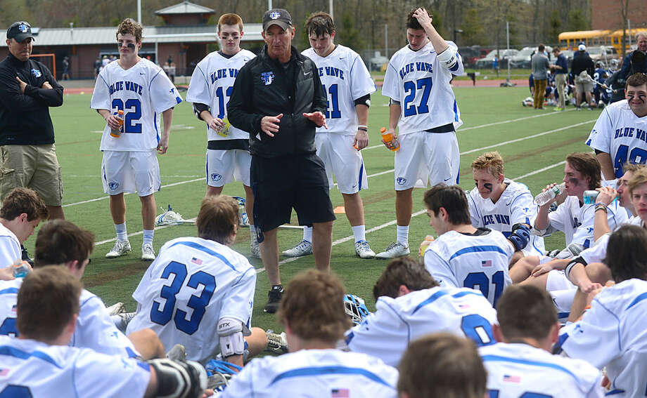 Darien High School's Boys Lacrosse coach Jeff Brameier talks to his team at halftime during their game against Wilton High School on Saturday, April 22, 2016, at Darien High School in Darien, Conn.