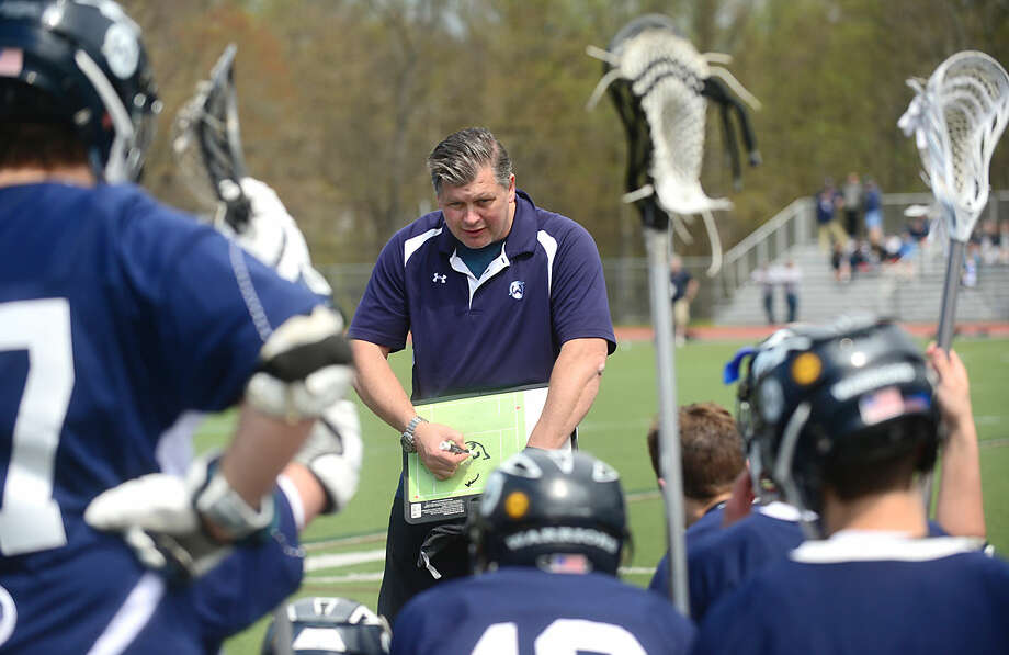 Wilton High School's Boys Lacrosse coach John Wiseman talks to his team at halftime during their game against Darien on Saturday, April 22, 2016, at Darien High School in Darien, Conn.