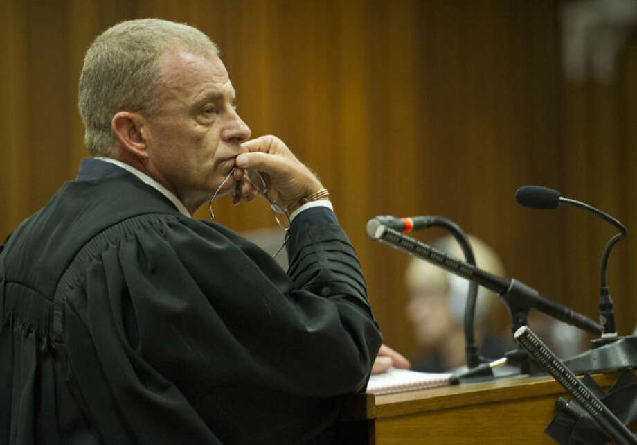 State prosecutor, Gerrie Nel, questions Oscar Pistorius in court in Pretoria, South Africa, Friday, April 11, 2014. Pistorius is charged with the murder of his girlfriend Reeva Steenkamp, on Valentines Day in 2013. (AP Photo/Craig Nieuwenhuizen, Pool)