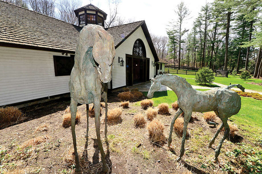 Hour photo / Erik Trautmann The Horse Barn, part of a 128 acre Luxury Equestrian Estate for sale in Wilton, was designed by famed architect Bartholomew Vorrsanger and has two Tack Rooms.