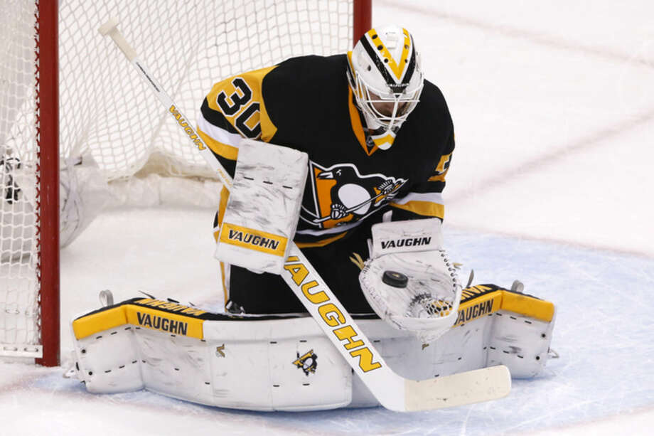 Pittsburgh Penguins goalie Matt Murray (30) stops a shot during the first period of Game 5 in a first-round NHL playoff hockey game against the New York Rangers in Pittsburgh, Saturday, April 23, 2016. (AP Photo/Gene J. Puskar)