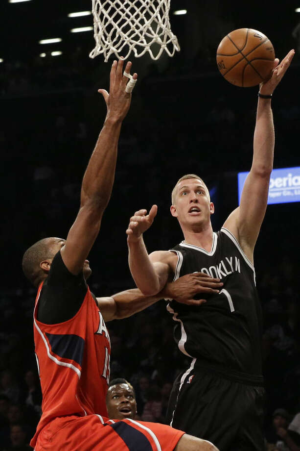 Brooklyn Nets center Mason Plumlee (1) goes to the basket agains Atlanta Hawks center Al Horford (15) during the first half in Game 3 of a first-round NBA basketball playoff series, Saturday, April 25, 2015, at New York. (AP Photo/Mary Altaffer)