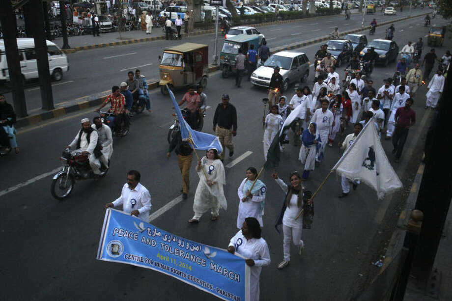 Pakistani peace activists rally to highlight the importance of tolerance in a peaceful society and demand concrete measures to deal the ongoing extremism and terrorism, in Lahore, Pakistan, Friday, April 11, 2014. (AP Photo/K.M. Chaudary)