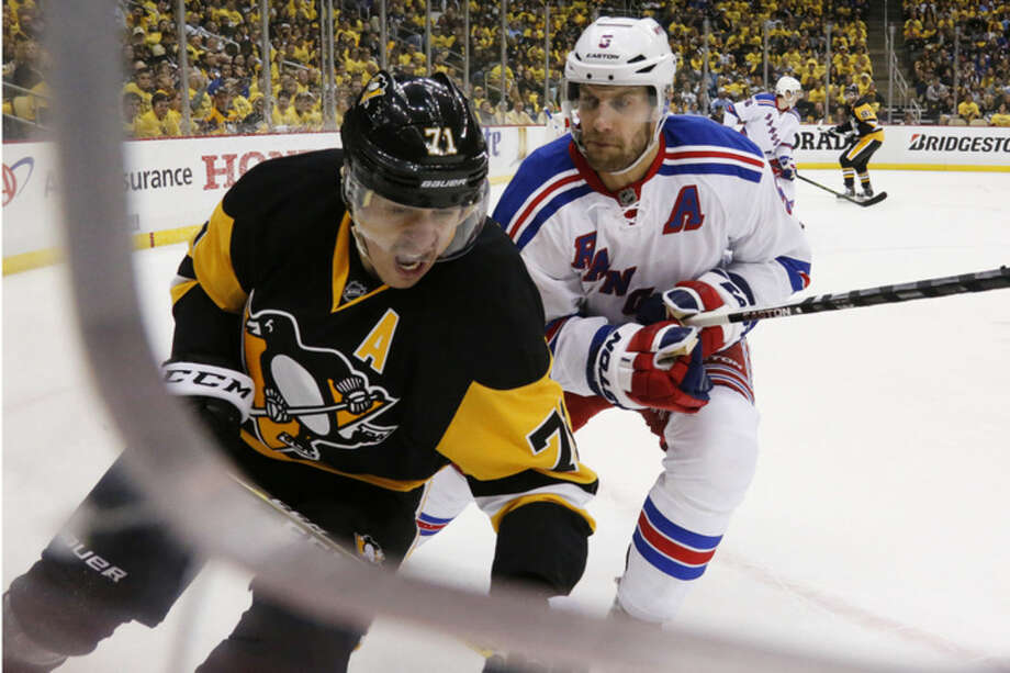 Pittsburgh Penguins' Evgeni Malkin (71) prepares for a check from New York Rangers' Dan Girardi (5) during the second period in Game 5 of a first-round NHL playoff hockey game in Pittsburgh, Saturday, April 23, 2016. (AP Photo/Gene J. Puskar)