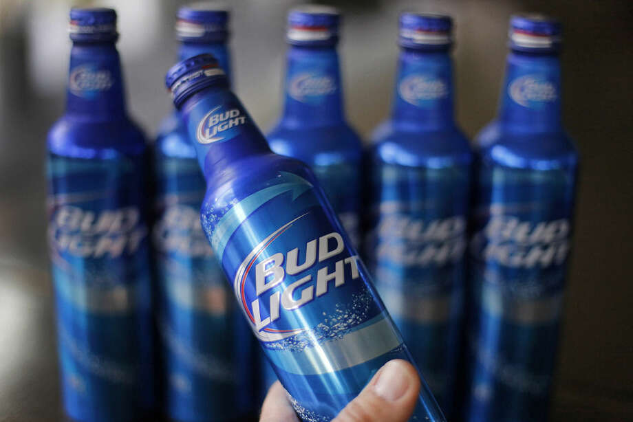 FILE - In this Monday, April 7, 2014, file photo, aluminum bottles of Bud Light beer are on display at Alcoa headquarters in Pittsburgh.