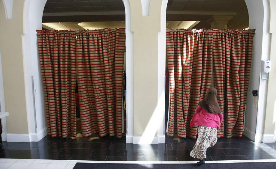 "A young girl runs into her mosque during ""a call to prayers"" at the Islamic Society of Boston Cultural Center Friday, April 24, 2015, in Boston. On Friday, the Boston mosque held an open house themed ""Still Boston Strong."" Organizers stressed the Tsarnaevs and other convicted terrorists are not representative of their faith communities. (AP Photo/Stephan Savoia)"