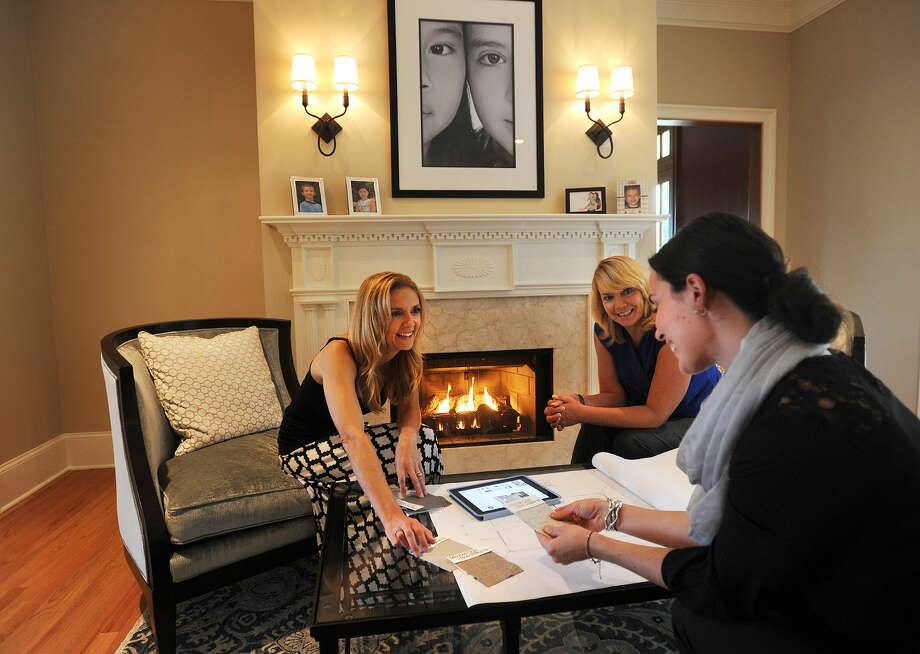 From left; Interior designer Jody Fierz, of Bethel, consults with Charlene Clark of Connecticut Lighting Center in Hartford and Michele Bruen of Mitchell Gold + Bob Williams furniture store in Greenwich, on the design choices for a customer's home in Westport, Conn. on Wednesday, September 10, 2014.