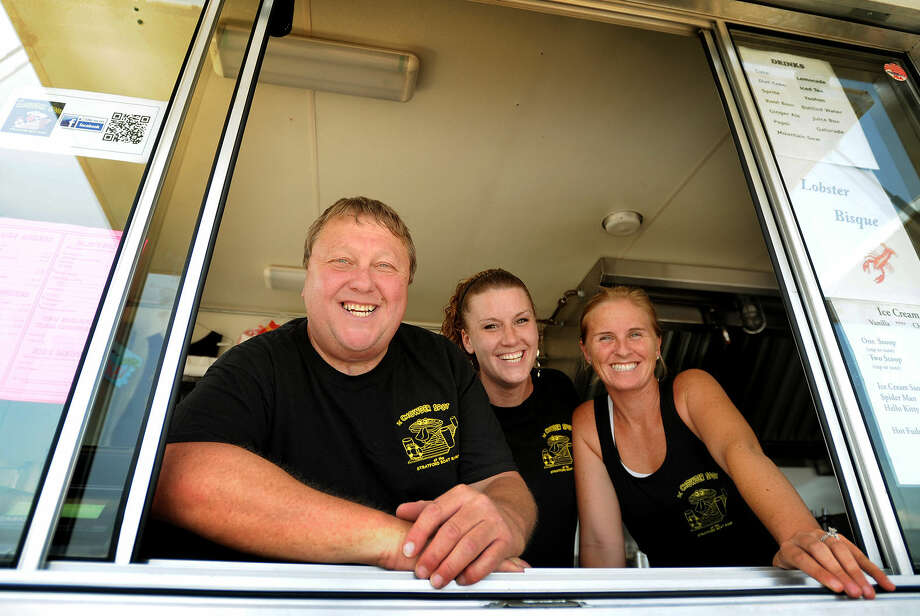 From left; Owner Jeff Donaldson, Jennifer VanDijk, and Heather Gladue, all of Milford, at The Chowder Spot food truck at the Stratford Boat Launch at 2 Birdseye Street in Stratford, Conn. on Tuesday, July 22, 2014.