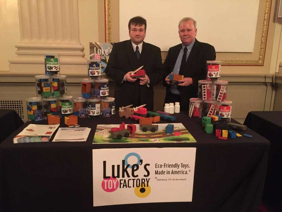 Luke Barber, left, and his father, James Barber, right, the founders of Danbury based Luke's Toy Factory attend a Small Business Development Center event this week in Washington D.C.