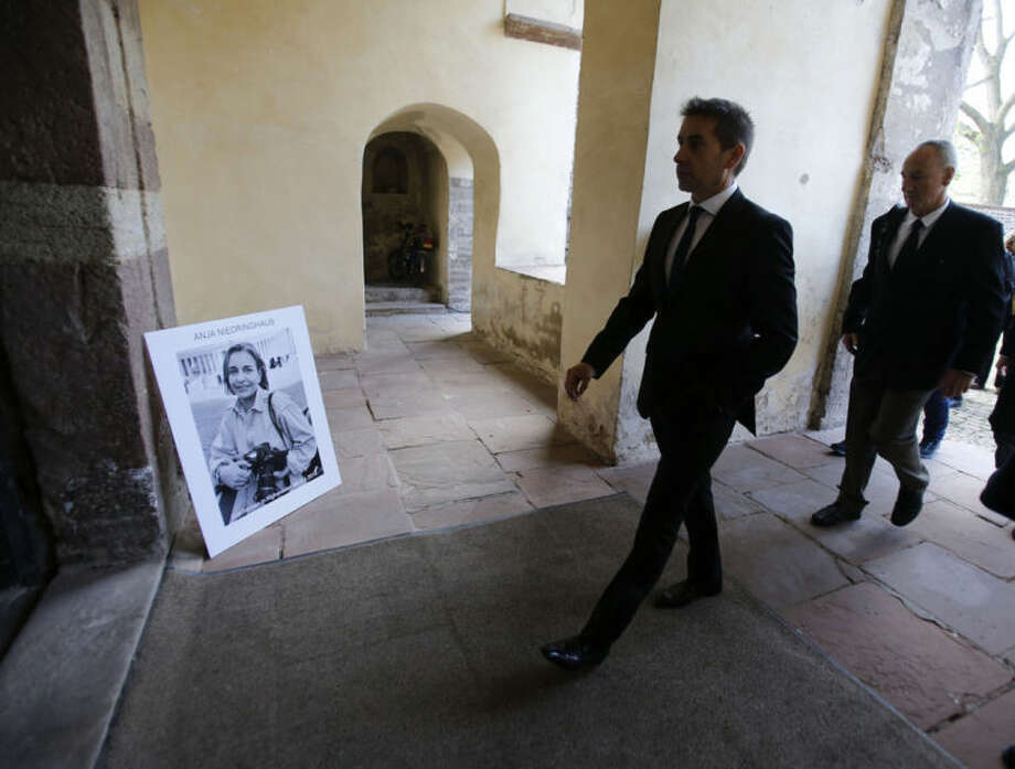 Mourners arrive at Corvey Abbey to attend the funeral of Associated Press photojournalist Anja Niedringhaus in Hoexter, Germany, Saturday, April 12, 2014. Niedringhaus was killed by an Afghan policeman in an attack on April 4, 2014 in Afghanistan. (AP Photo/Frank Augstein, pool)