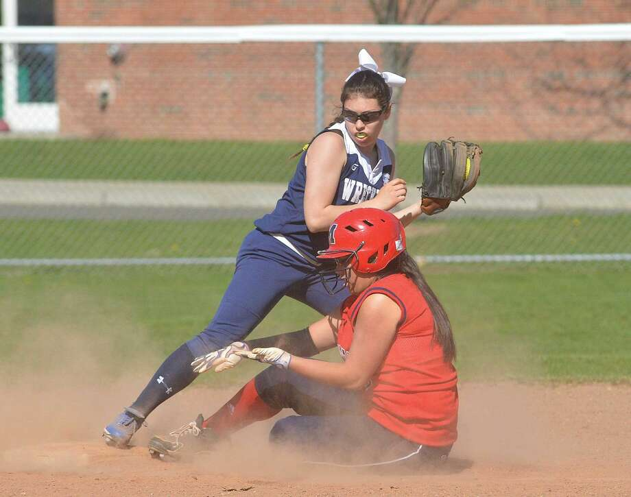 Staples's Gabriella Perry is late to the bag as McMahon's Tori Rodriguez slides safely into second. (Hour Photo/Alex von Kleydorff)