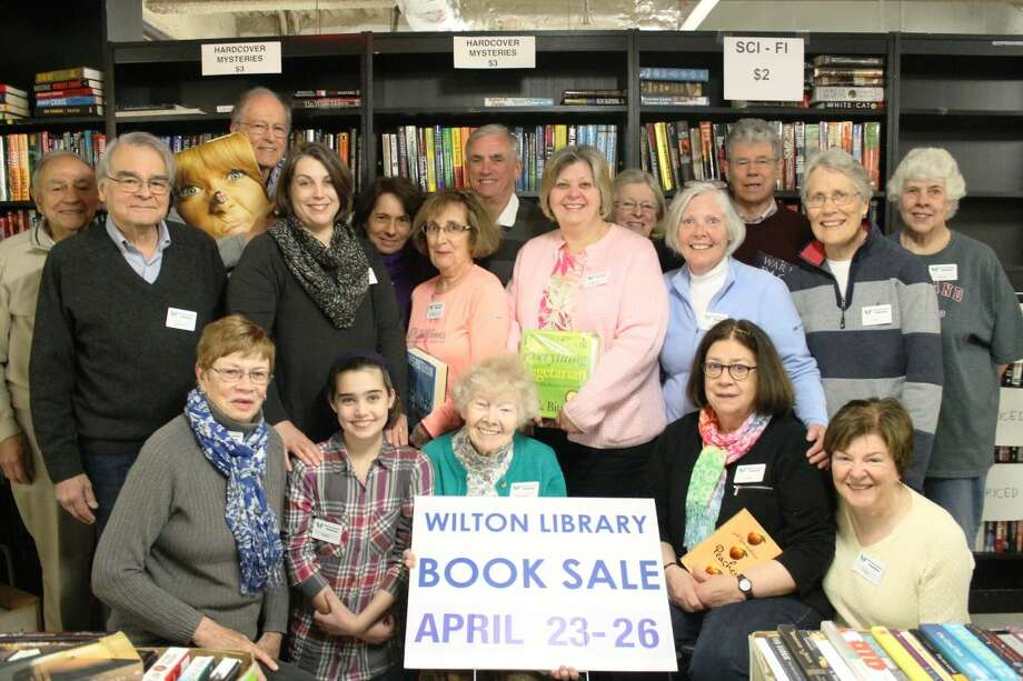 Wilton Library's Annual Gigantic Book Sale fundraiser is Saturday, April 23 through Tuesday, April 26. Library volunteers work painstakingly throughout the year to sort, clean, cull and categorize more than 70,000 items. Pictured here are just a few of the hardworking volunteers who make this fundraiser possible: back row (l-r) Phil Cannella, Michael Fein, Ed MacEwen, Amy Kirk, JoAnn Ciavarelli, Pat Tully, Jim Burch, Linda Cannella, Barbara Quincy, Barbara Quist, Kit Smith, Jan MacEwen, Nancy Wollard; front row seated (l-r): Jan Galletly, Sally Kirk, Michaela Durkin, Linda Fein and Pat Gould.