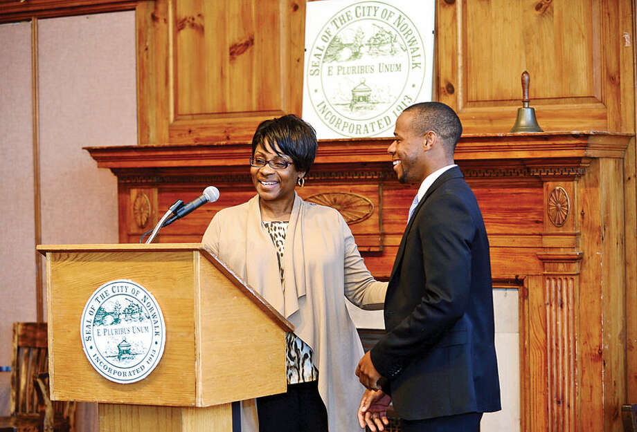 Hour photo / Erik Trautmann Summer Youth Employment coordinator Darlene Young welcomes former program participant Shadram Thelusa during the 2nd annual Mayor's Summer Youth Employment Breakfast Wednesday at City Hall where businesses learned of the benefits of interning Norwalk High School students.
