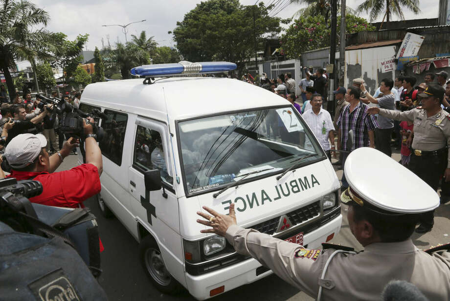 One of ambulances carrying the bodies of Australian death-row prisoners Andrew Chan and Myuran Sukumaran arrives at a funeral home in Jakarta, Indonesia, Wednesday, April 29, 2015. Indonesia brushed aside last-minute appeals and executed eight people convicted of drug smuggling on Wednesday, although a Philippine woman was granted a stay of execution. (AP Photo/Achmad Ibrahim)