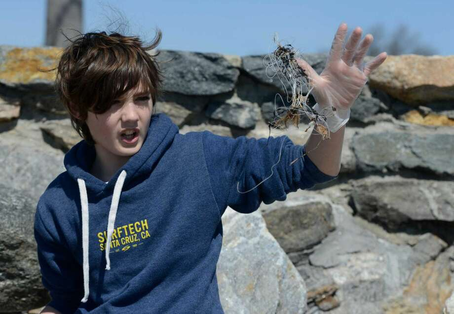 Ben Apicella, a sixth-grader from King Academy, collects garbage.
