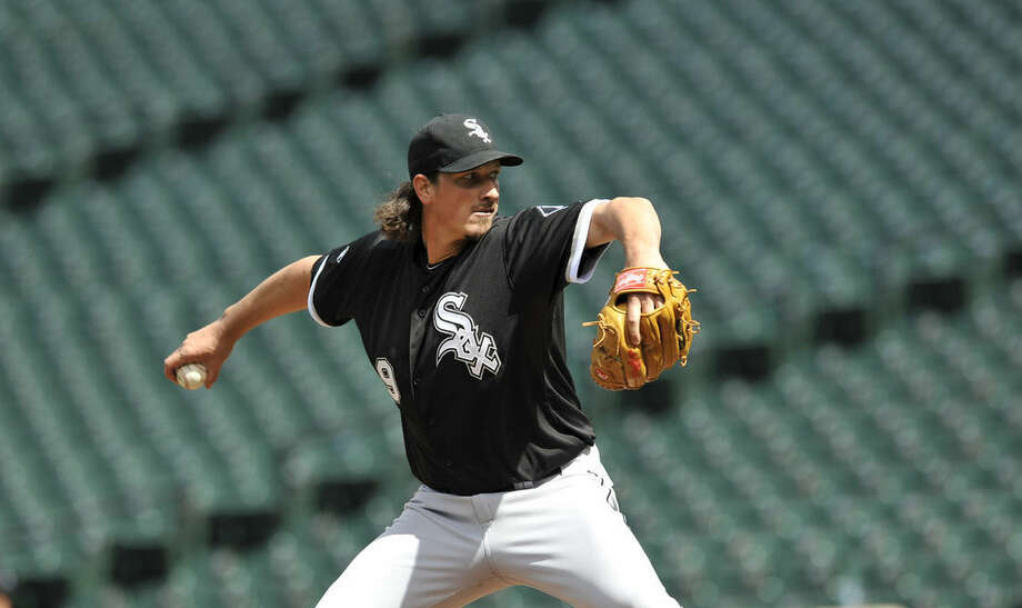 Chicago White Sox starter Jeff Samardzija delivers against the Baltimore Orioles in the fifth inning of a baseball game, Wednesday, April 29, 2015, in Baltimore. Due to security concerns the game was closed to the public. The Orioles won 8-2.(AP Photo/Gail Burton)