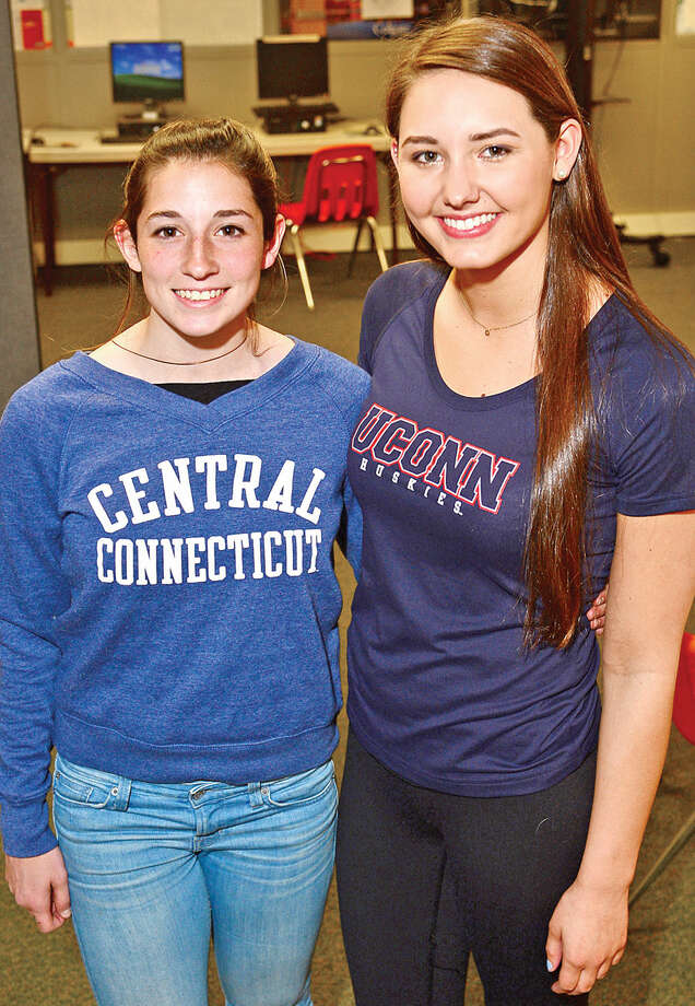 Hour photo / Erik Trautmann Norwalk's latest Division 1 athletes, Sabrina Kruy (CCSU) for girls soccer and Katie Wargo (UConn) in swimming.