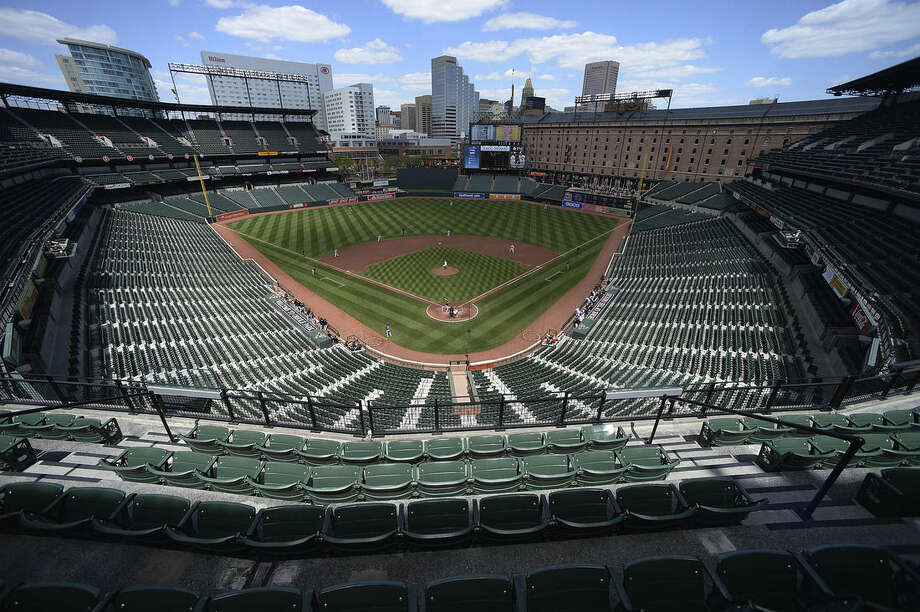 Baltimore Orioles pitcher Ubaldo Jimenez delivers a pitch against the Chicago White Sox in the first inning of a baseball game without fans Wednesday, April 29, 2015, in Baltimore. Due to security concerns the game was closed to the public. (AP Photo/Gail Burton)