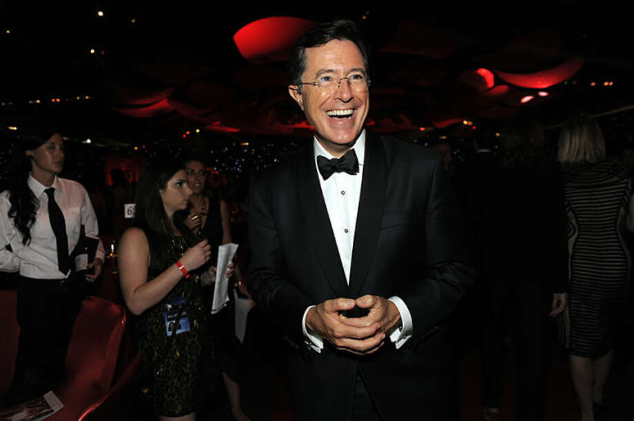 "FILE - This Sept. 23, 2012 file photo shows TV personality Stephen Colbert at the 64th Primetime Emmy Awards Governors Ball in Los Angeles. CBS on Thursday, April 10, 2014, announced that Colbert, the host of ""The Colbert Report,"" will succeed David Letterman as the host of ""The Late Show."" (Photo by Chris Pizzello/Invision/AP, File)"