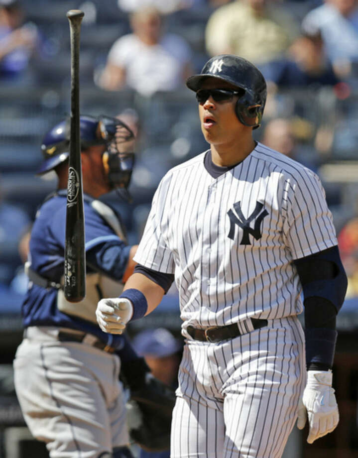 New York Yankees designated hitter Alex Rodriguez (13) tosses his bat after striking out looking in the sixth inning of a baseball game against the Tampa Bay Rays at Yankee Stadium in New York, Wednesday, April 29, 2015. (AP Photo/Kathy Willens)