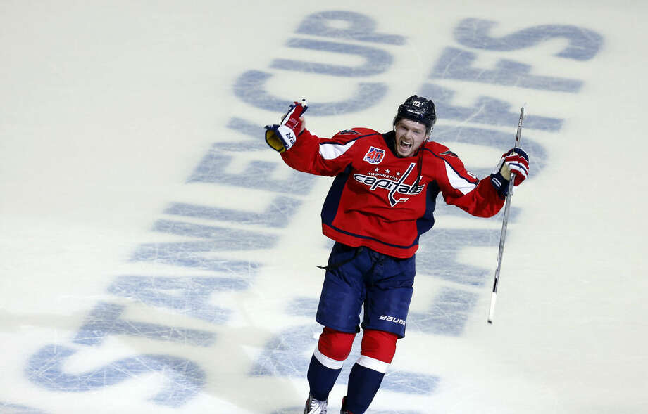 Washington Capitals center Evgeny Kuznetsov (92), from Russia, celebrates after Game 7 in the first round of the NHL hockey Stanley Cup playoffs against the New York Islanders, Monday, April 27, 2015, in Washington. Kuznetsov scored the game winning goal and the Capitals won 2-1, to advance. (AP Photo/Alex Brandon)