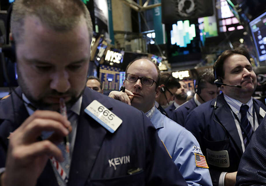 Traders work on the floor of the New York Stock Exchange, Friday, April 11, 2014. Weaker earnings at JPMorgan Chase are dragging bank stocks lower in early trading. Technology and biotech stocks also fell, a day after the worst rout for the Nasdaq composite index since 2011. (AP Photo/Richard Drew)
