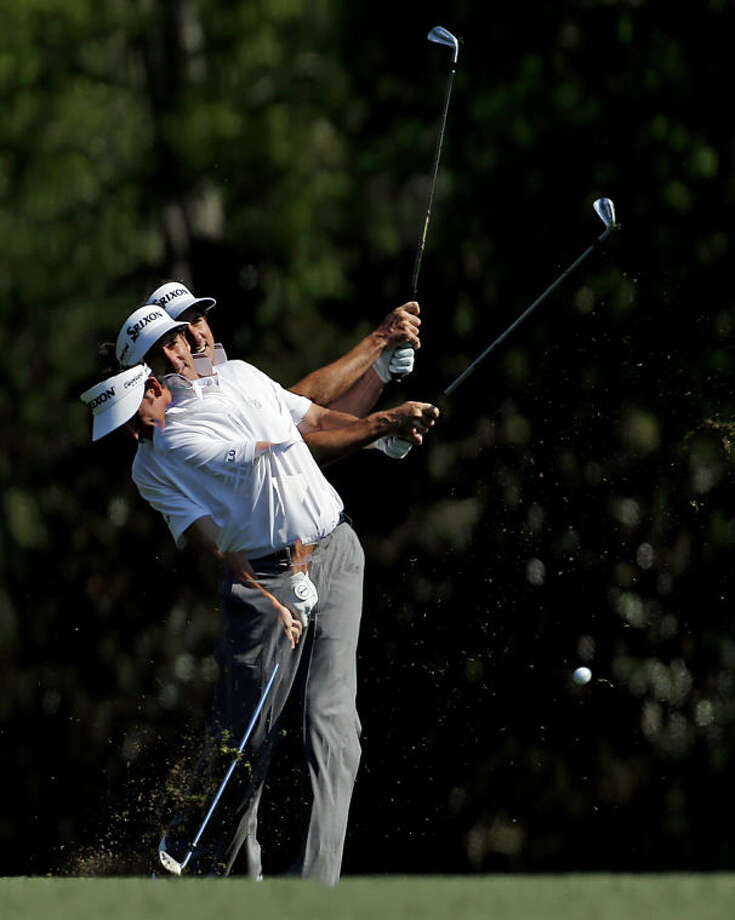 In a photo taken with a multiple exposure, Gonzalo Fernandez-Castano, of Spain, hits off the fifth fairway during the second round of the Masters golf tournament Friday, April 11, 2014, in Augusta, Ga. (AP Photo/Matt Slocum)