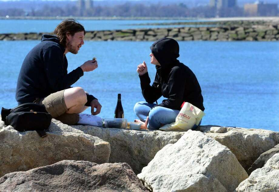 Heading home to Old Lyme, Bryan Gormeau and co-worker Christina Goldberg have lunch together after attending Artexpo 2016 at Pier 94 in New York City at Long Beach in Stratford, Conn., on Saturday Apr. 16, 2016. Gormeau and Goldberg work together at Studio 80 in Old Lyme and had a sculpture on display at the expo.