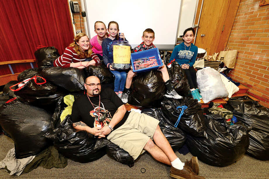 Hour photo / Erik Trautmann Roton Middle School 7th graders Julia Arsenault, Nicole Baldwin, Liv Mulligan, Wyatt Machette and Citlaly Ibarra and their teacher Mark Jacksonorganized a fundraiser for Africa where the raised over $500 in cash and had over 4000 pieces of clothing donated.