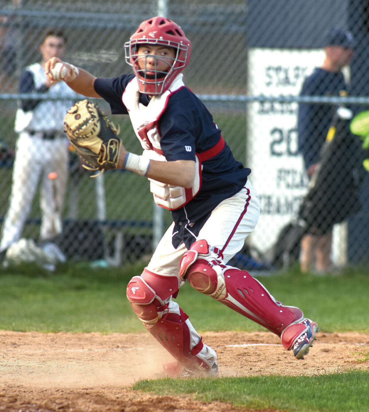 Hour photo/John Nash - McMahon catcher Hunter Dumas comes up firing after receiving the ball at the plate after Staples scored a run in the Wreckers 11-0 win over Brien McMahon.