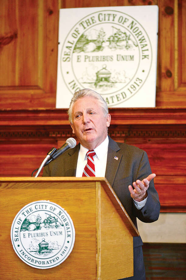 Hour photo / Erik Trautmann Norwalk Mayor Harry Rilling addresses the audience during the 2nd annual Mayor's Summer Youth Employment Breakfast Wednesday at City Hall where businesses learned of the benefits of interning Norwalk High School students.