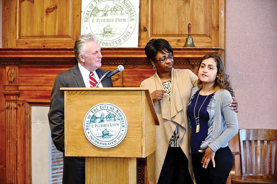 Hour photo / Erik Trautmann Norwalk Mayor Harry Rilling and Summer Youth Employment coordinator Darlene Young welcome former program participant Joanna Valencia during the 2nd annual Mayor's Summer Youth Employment Breakfast Wednesday at City Hall where businesses learned of the benefits of interning Norwalk High School students.