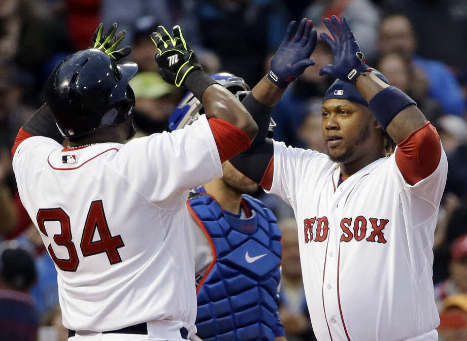 Boston Red Sox's Hanley Ramirez, right, celebrates his two-run homer which drove in designated hitter David Ortiz (34) in the third inning of a baseball game against the Toronto Blue Jays at Fenway Park in Boston, Wednesday, April 29, 2015. (AP Photo/Elise Amendola)
