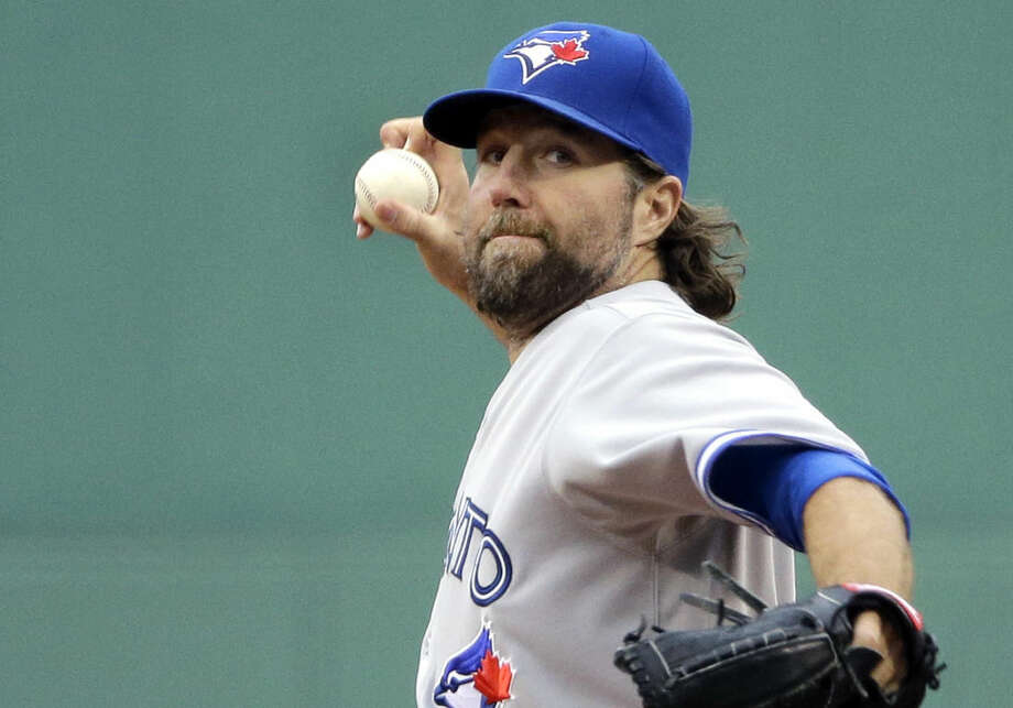 Toronto Blue Jays starting pitcher R.A. Dickey delivers to the Boston Red Sox in the first inning of a baseball game at Fenway Park in Boston, Wednesday, April 29, 2015. (AP Photo/Elise Amendola)