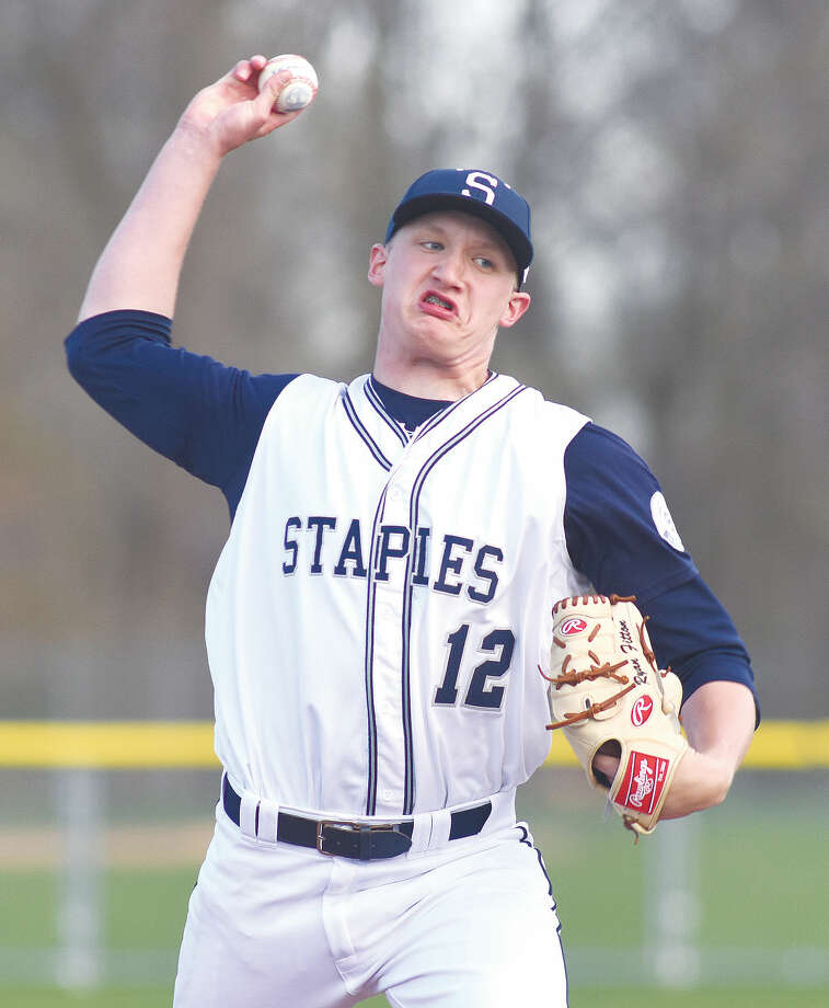 Hour photo/John Nash - Staples sophomore starting pitcher Ryan Fitton fires to the plate during his three-hit, complete-game win over Brien McMahon on Wednesday. Fitton struck out eight and didn't walk a batter in the Wreckers' 11-0 win.