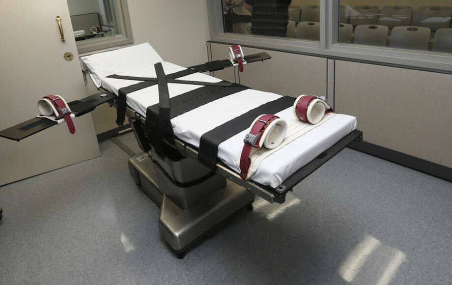 FILE - In this Thursday, Oct. 9, 2014 photo, the gurney in the the execution chamber at the Oklahoma State Penitentiary is pictured in McAlester, Okla. Oklahoma plans to resume executions Thursday, Jan. 15, 2015, after botching its last one and will use the same three-drug method as a Florida lethal injection scheduled for the same day. (AP Photo/Sue Ogrocki, File)