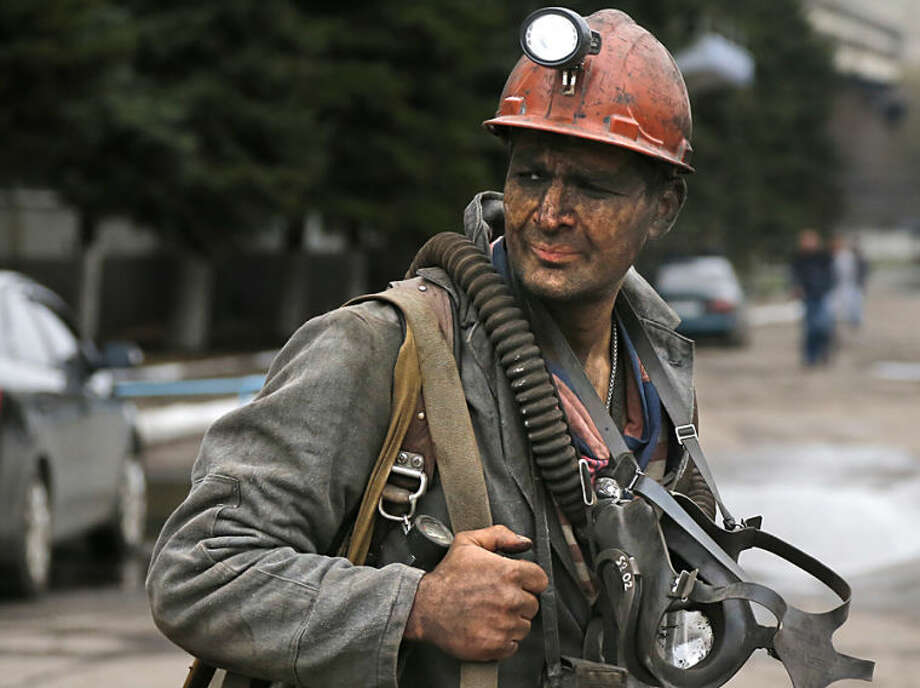 A Ukrainian rescue worker leaves the Skochinsky mine in Donetsk, Ukraine, Friday, April 11, 2014. Several people were killed in a gas explosion at a coal mine in eastern Ukraine on Friday, officials said. The Emergency Services Ministry said Seventy-eight people were working in the mine when the blast occurred early Friday morning. They said it was provoked by a sudden release of gas during work in the drilling pits. 13 rescue teams and five resuscitation and anti-shock teams were dispatched to the scene of the accident, officials said. (AP Photo/Andrey Basevich)
