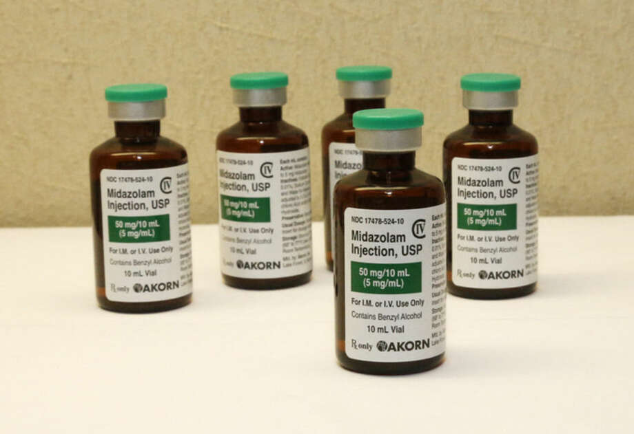 FILE - This July 25, 2014 file photo shows bottles of the sedative midazolam at a hospital pharmacy in Oklahoma City. Exactly one year after a botched lethal injection, attorneys for other Oklahoma death row inmates were set to ask the U.S. Supreme Court Wednesday, April 29, 2015 to outlaw a sedative used in the procedure — a ruling that could force several states to either find new execution drugs or change the way they put prisoners to death. (AP Photo/Sue Ogrocki, File)