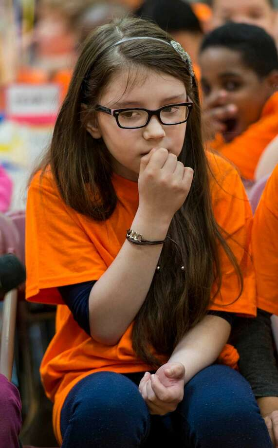 Anastasia Ladyka of the Orange team room 506 thinks hard to come up with an answer to a question during The Battle of the Books event at Roxbury Elementary School, Stamford, CT on Friday, April 15, 2016.