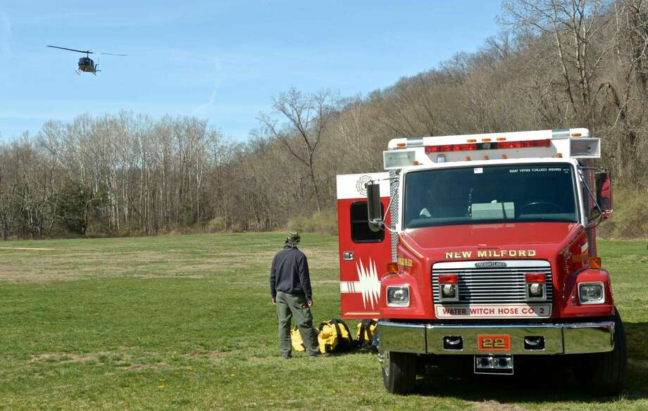 Eagle 1 search and rescue helicopter lands in Clatter Valley Park, in New Milford, to take part in a search and rescue drill along with fire departments, police, EMS, K-9, and others on Saturday, April 16, 2016, in New Milford, Conn.