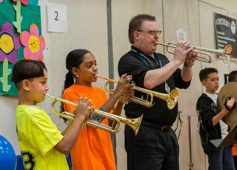 Kiko Ivanov, Alyssa Bautista and teacher Graham Leftwich play a number at the start of The Battle of the Books event at Roxbury Elementary School, Stamford, CT on Friday, April 15, 2016.
