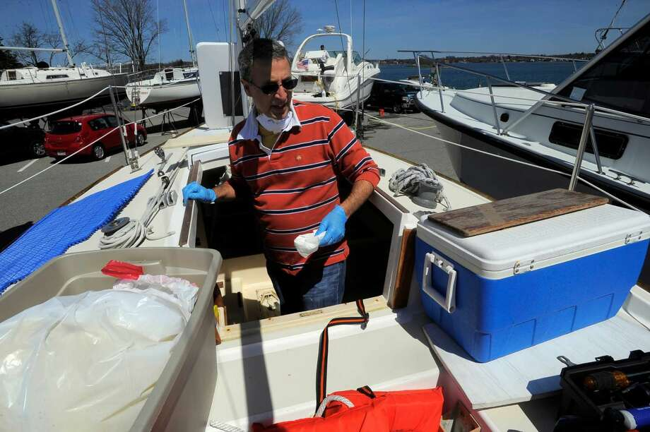 Jose Sousa of Cos Cob cleans his boat in preparation for launch at Todds Point in Old Greenwich on April 16, 2016. Sousa is an avid sailor and is excited to get back to sailing every weekend on his J-24 class sail boat with his wife.