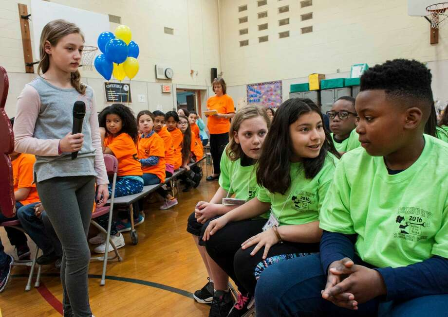 Lilah Scherer, Daniela Urruela and Eric Tucker of the Green team room 507 confer to come up with an answer to a question as Alyssa Strezoski (left) waits for their answer during The Battle of the Books event at Roxbury Elementary School, Stamford, CT on Friday, April 15, 2016.